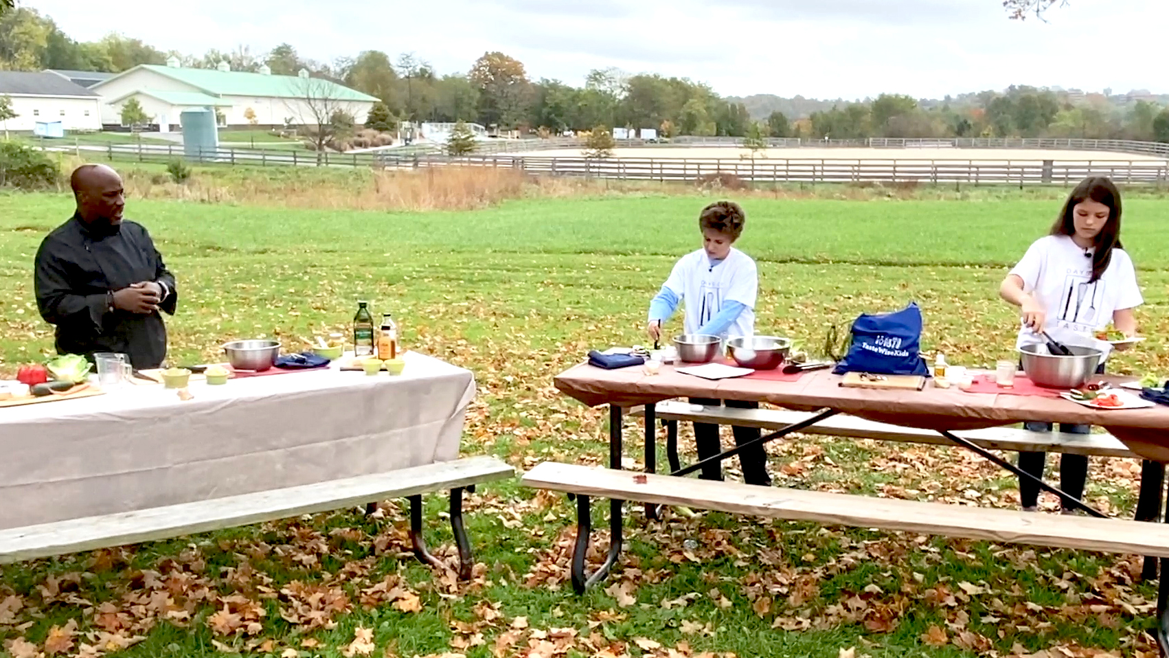 people at picnic tables preparing food